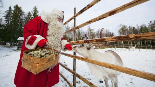 joulupukki-ja-poro-visit-finland